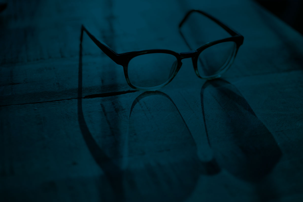 Background image of glasses on an appointment book