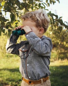 Young child using binoculars