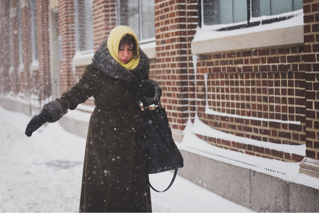 Woman walking carefully in snow
