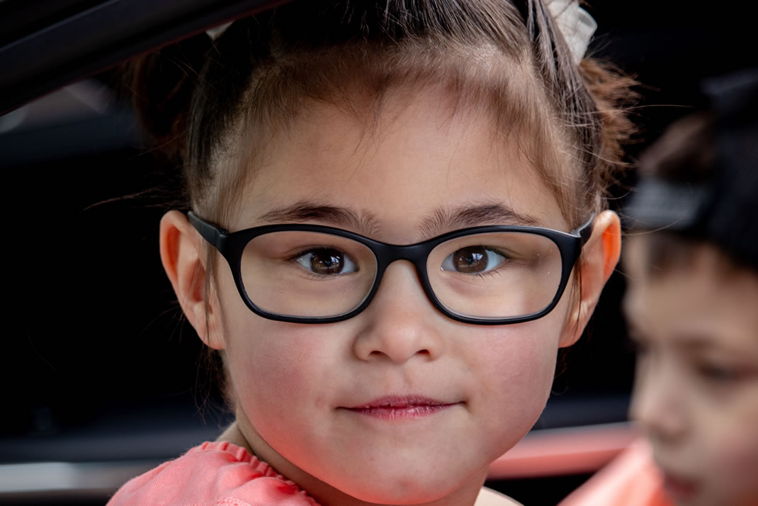 Young child wearing glasses