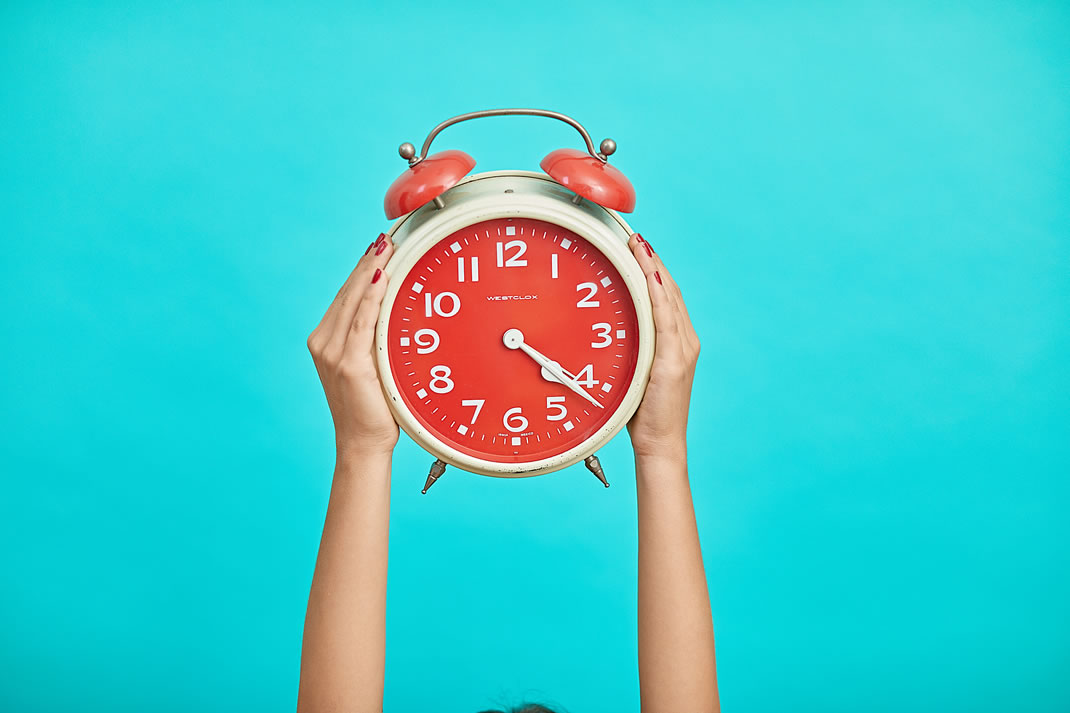 Bright red clock on a blue background